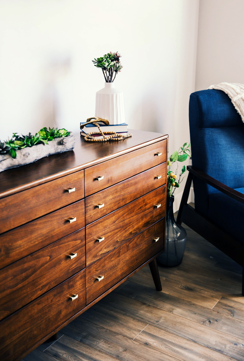 Creating a cozy minimalist home, consider rustic or vintage furniture