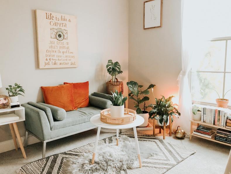 Creating a cozy minimalist home, area Rugs or cushy carpets provide comfort & coziness