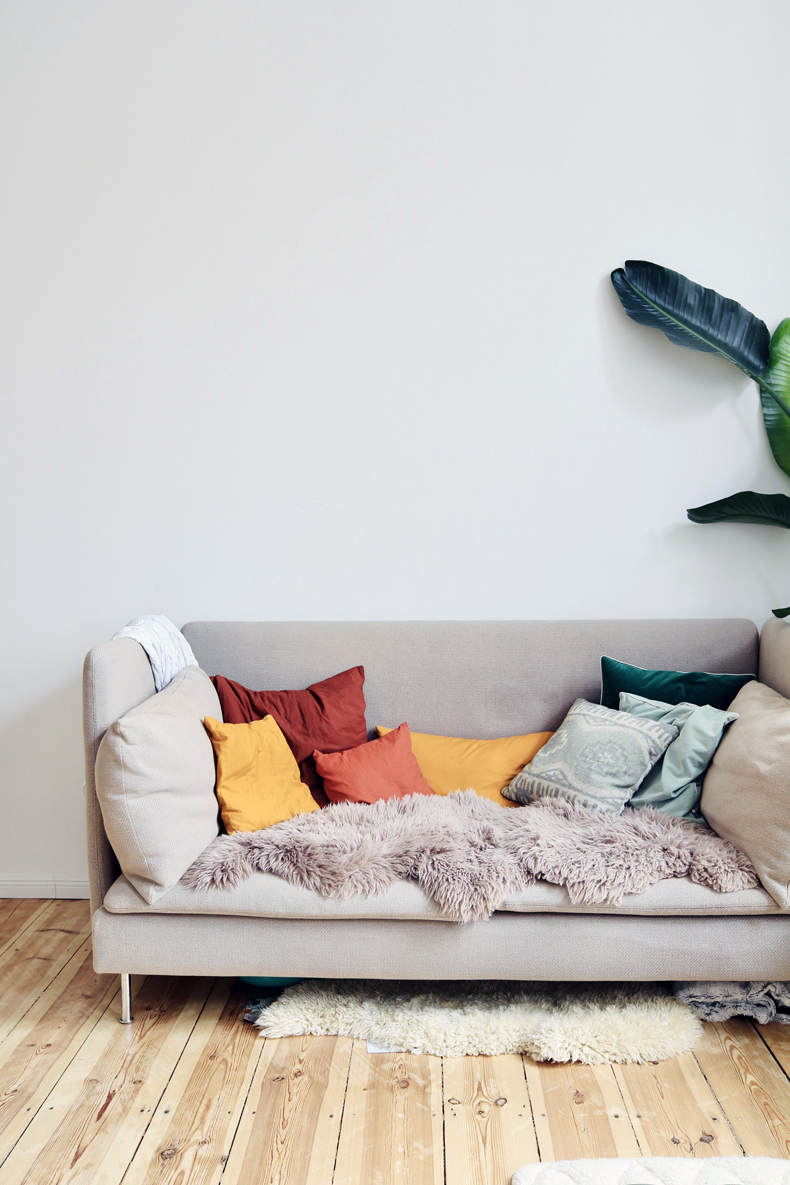 Creating a cozy minimalist home, incorporate warm colors